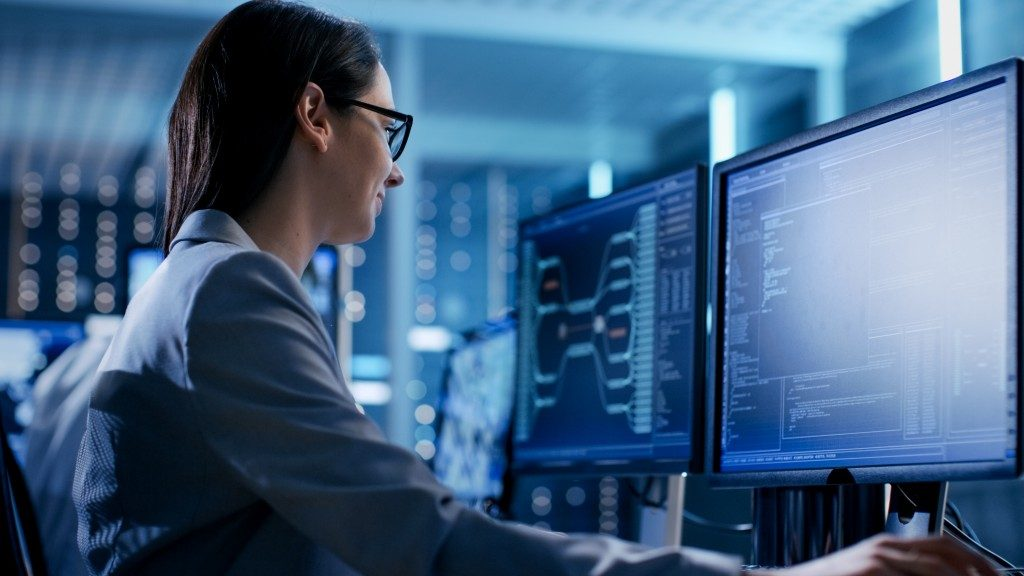 Female IT Engineer Working in Monitoring Room