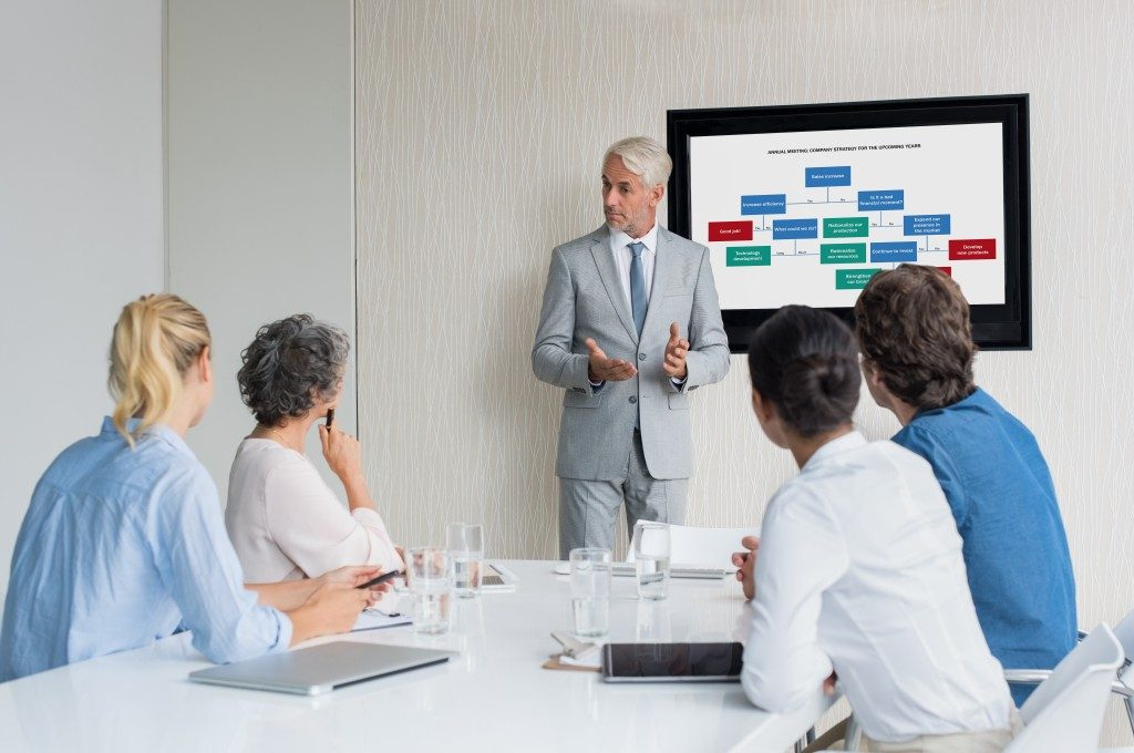 businessman doing a presentation inside a conference room