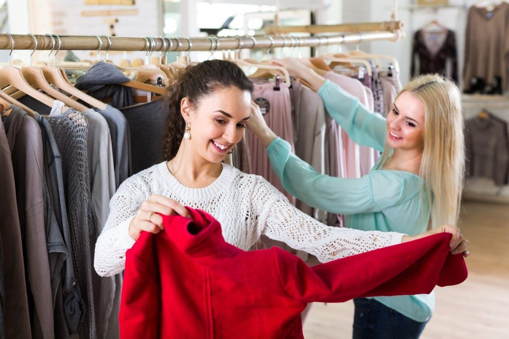 women shopping for sweaters
