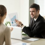 businessman presenting a graph to a client