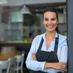 Restaurant business owner smiling