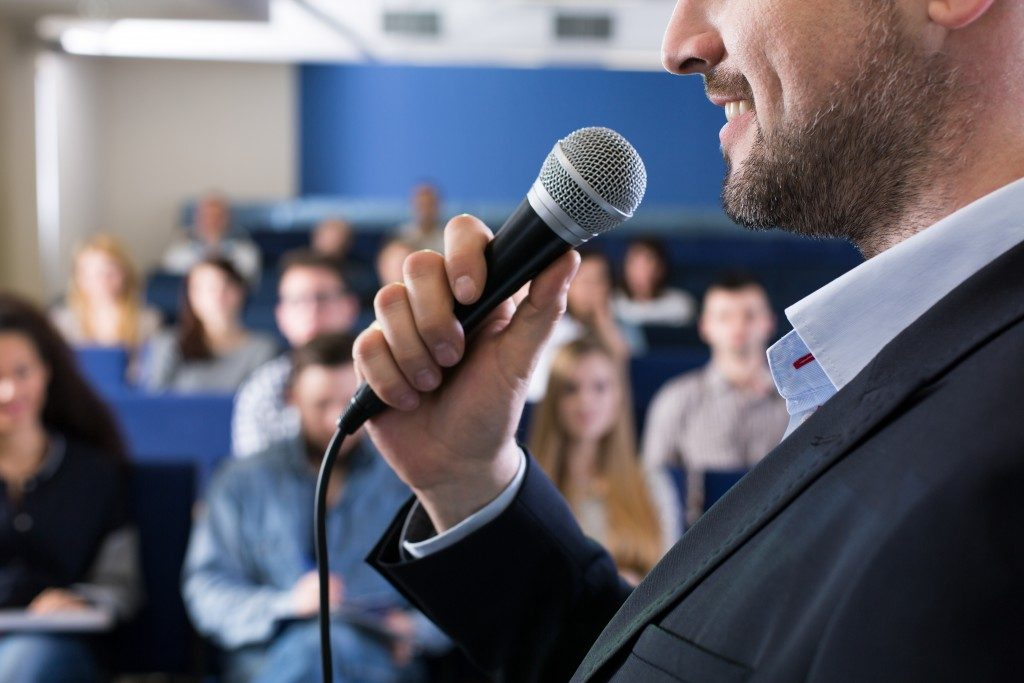 speaker holding a microphone