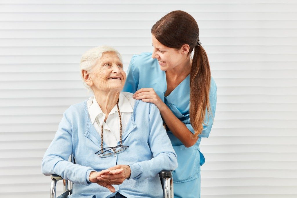 woman smiling at an old woman