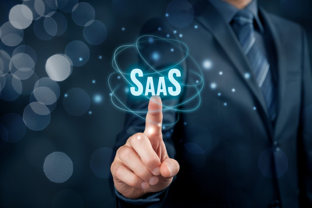 businessman pointing to a virtual SaaS text