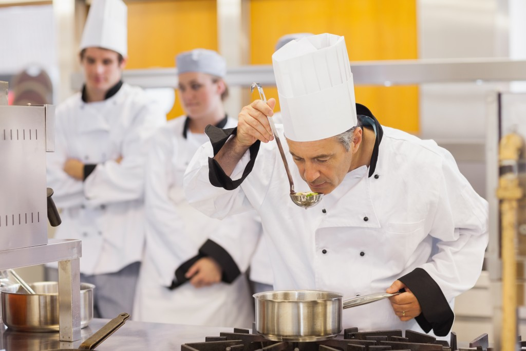 Chef tasting his food
