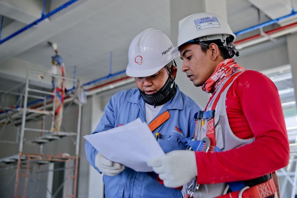 industrial workers reading instructions