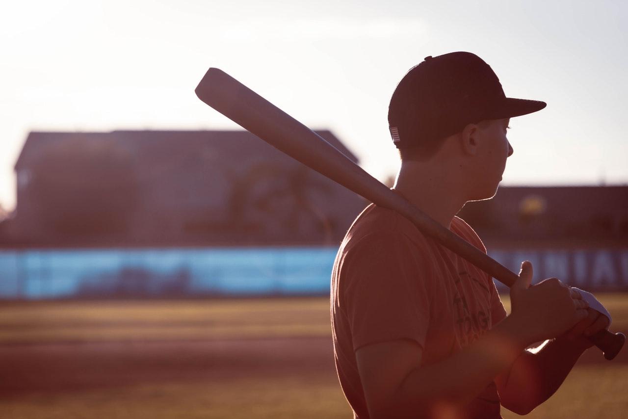 man holding a baseball bat