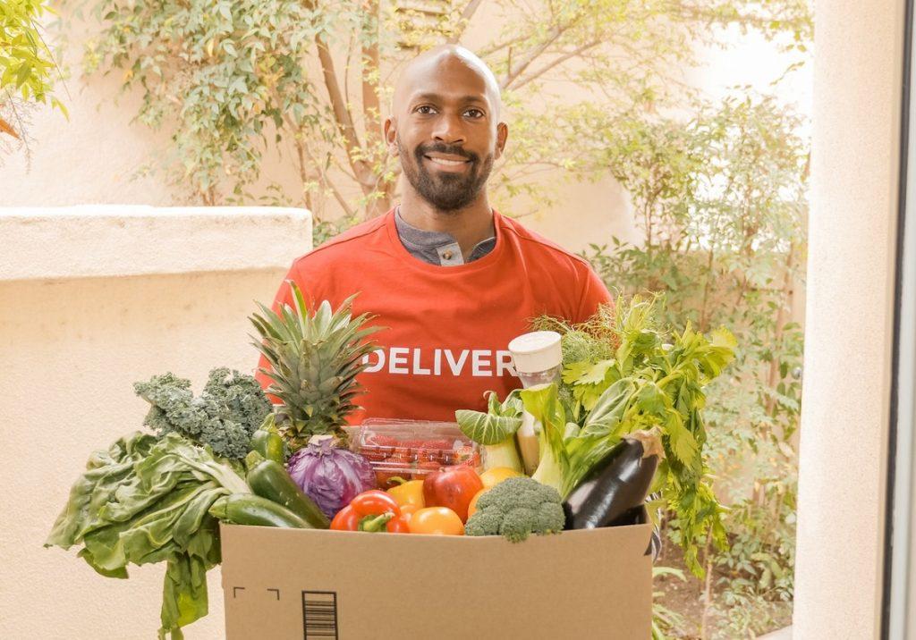 man delivering vegetables