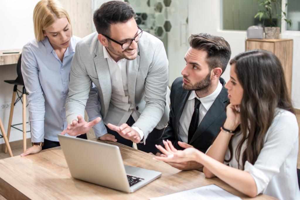 entrepreneur talking to employees
